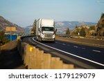 big rig white long haul semi...   Shutterstock . vector #1179129079
