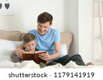 father and his son reading book ... | Shutterstock . vector #1179141919