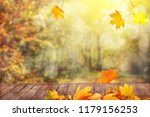 autumn leaves and wooden table | Shutterstock . vector #1179156253