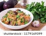stewed eggplant. tasty... | Shutterstock . vector #1179169399