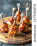 chicken drumsticks in barbecue... | Shutterstock . vector #1179183076