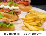 hot dog with grilled sausage... | Shutterstock . vector #1179189049