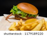 bacon cheeseburger on a crusty... | Shutterstock . vector #1179189220