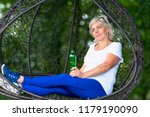 older woman with white hair... | Shutterstock . vector #1179190090