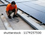 fitting photovoltaic panels on... | Shutterstock . vector #1179257530
