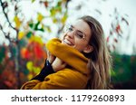 woman smile in autumn with... | Shutterstock . vector #1179260893