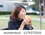 chinese girl sitting on the... | Shutterstock . vector #1179272533