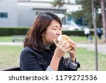 chinese girl sitting on the... | Shutterstock . vector #1179272536