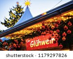 gluhwein hot wine sign plate at ... | Shutterstock . vector #1179297826