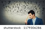 thoughtful stressed young man... | Shutterstock . vector #1179306286