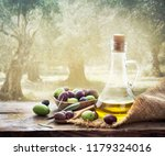 olives and bottle of extra... | Shutterstock . vector #1179324016