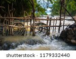 fish trap in mekong river  when ... | Shutterstock . vector #1179332440