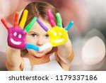 little girl with painted hands | Shutterstock . vector #1179337186
