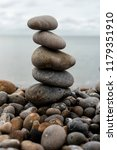 stack of pebbles on the beach... | Shutterstock . vector #1179351910
