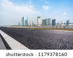 empty asphalt road with city... | Shutterstock . vector #1179378160