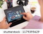 man using digital tablet for... | Shutterstock . vector #1179395629