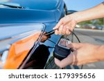 measuring thickness of the car... | Shutterstock . vector #1179395656