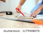 young man measuring and marking ... | Shutterstock . vector #1179408070