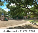pathway and iron picnic tables... | Shutterstock . vector #1179411940