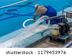 cleaning the sports pool with a ... | Shutterstock . vector #1179453976