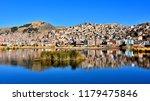 city of puno reflected in... | Shutterstock . vector #1179475846
