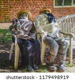 Two Scarecrows On Chairs...