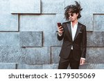 curly stylish asian guy in the... | Shutterstock . vector #1179505069