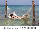 woman lying in a hammock which... | Shutterstock . vector #1179505303