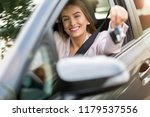 young woman sitting in car... | Shutterstock . vector #1179537556