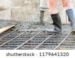 workers pour the foundation for ... | Shutterstock . vector #1179641320