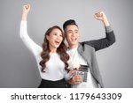young couple hold pink pig bank ... | Shutterstock . vector #1179643309