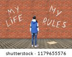 little girl wrote with a chalk... | Shutterstock . vector #1179655576