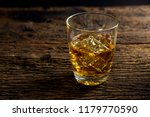 whiskey with ice in glasses... | Shutterstock . vector #1179770590