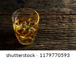 whiskey with ice in glasses... | Shutterstock . vector #1179770593