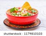 bowl of fresh mexican pico de...   Shutterstock . vector #1179810103
