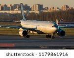 widebody passenger airplane.... | Shutterstock . vector #1179861916