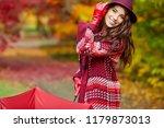 autumn woman in autumn park  ... | Shutterstock . vector #1179873013