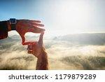 hands framing view distant over ... | Shutterstock . vector #1179879289