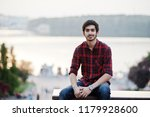 young indian student man at red ... | Shutterstock . vector #1179928600