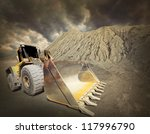 Excavator in the mine. Ecology disaster concept. - stock photo