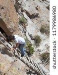 woman climbing a ladder on a... | Shutterstock . vector #1179986980