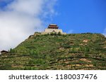 chinese temple at the top of a... | Shutterstock . vector #1180037476