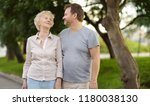 beautiful eldery woman and her... | Shutterstock . vector #1180038130