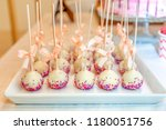 cake pops decorated with bows... | Shutterstock . vector #1180051756