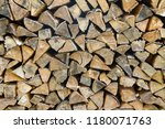 a pile of stacked firewood ... | Shutterstock . vector #1180071763