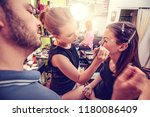 Makeup teacher helping students training to become makeup artist.