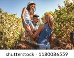beautiful young smiling family...   Shutterstock . vector #1180086559