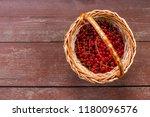 a basket of ripe juicy red... | Shutterstock . vector #1180096576