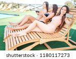 models sit on sunbeds and have... | Shutterstock . vector #1180117273