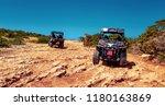 two buggies on sandy road...   Shutterstock . vector #1180163869